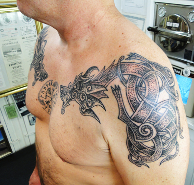 tribal fish skeleton tattoo